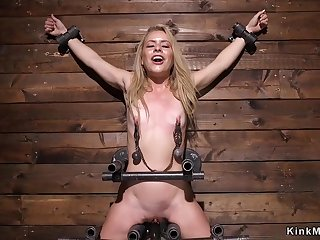 Blond Hair Babe there stock and metal bondage toyed