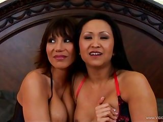 Guileful Asian milfs in fishnet stockings take aloft a big cock