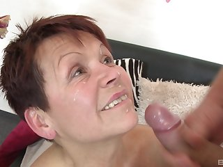 Short hair mature Emmi moans while obtaining fucked by a younger man